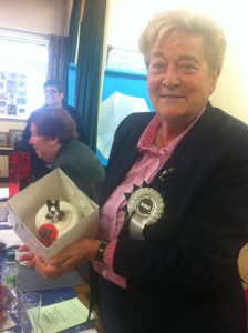 Liz Cartlidge with the cake presented to her. (Made by Sugar Pod)